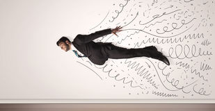 Business man flying with hand drawn lines comming out Royalty Free Stock Images