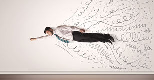 Business man flying with hand drawn lines comming out Stock Image