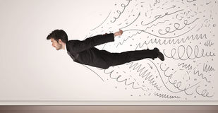 Business man flying with hand drawn lines comming out Royalty Free Stock Photo