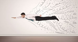 Business man flying with hand drawn lines comming out Royalty Free Stock Photos