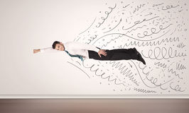 Business man flying with hand drawn lines comming out Stock Photography