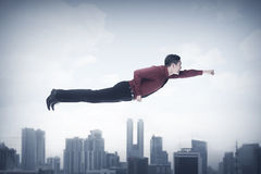 Business man flying Stock Images