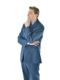 Business man with folded arms looking away Stock Images