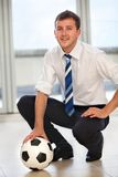 Business man with a football Royalty Free Stock Images