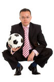 Business man and a football Royalty Free Stock Photos