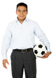 Business man with a football Royalty Free Stock Photography