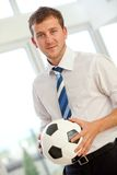 Business man with a football Stock Photo