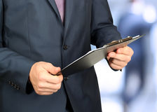 Business man in a formal suit  holding documents Stock Photo