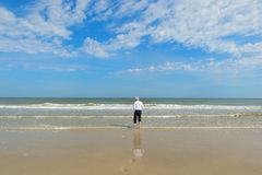 Business man walking in the sea royalty free stock photo