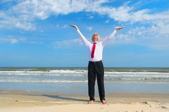 Business man zen at the beach stock photography