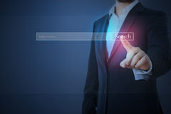 Business man in formal wear searching. Something in internet Royalty Free Stock Image