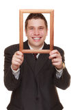 Business man framing his face with wood frame Stock Photos