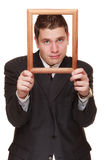 Business man framing his face with wood frame Stock Image