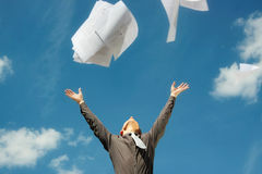 Business man freeing himself from his work load Royalty Free Stock Photography