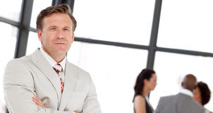 Business man in front of team Royalty Free Stock Image