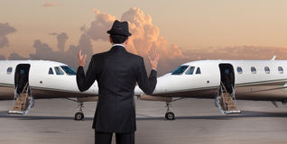 Business man in front of two private jets stock image