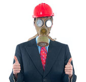 Business man with gas mask and helmet Stock Photography