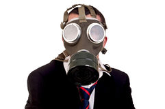 Business man with gas mask on white background Royalty Free Stock Photos
