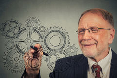 Business man with gears and ideas Stock Photos