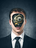 Business man with gears inside head on the gray Stock Photography