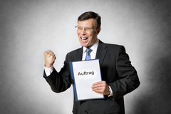 Business man with german contract Stock Photo