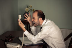 Business man gesturing aggressive and shout on phone Stock Photos