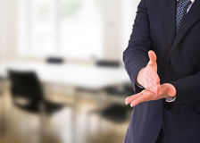 Businessman gesturing with both hands. Royalty Free Stock Photos