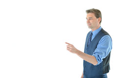 Business man gesturing with left arm. Successful Business man gesturing with left arm and finger with neutral expression Royalty Free Stock Photos