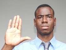 Business Man Gesturing Stop. A handsome adult black man Royalty Free Stock Image