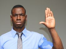 Business Man Gesturing Stop. A handsome adult black man Royalty Free Stock Photography