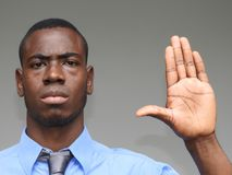 Business Man Gesturing Stop. A young male african adult Stock Photos