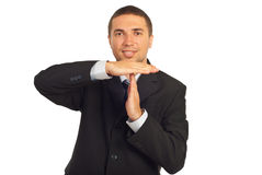 Business man gesturing time-out. And smiling isolated on white background Stock Image