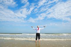 Business man standing in the sea royalty free stock photos