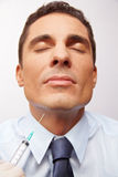 Business man getting cosmetic surgery Royalty Free Stock Images