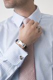 Business man getting ready for work. Business man with shirt and jewellery Royalty Free Stock Image