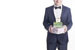 Business man with gifts (horizontal image). Business man with gifts (vertical image). A businessman offering a gift to you (selective focus Stock Images
