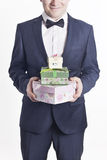 Business man with gifts (vertical image) Royalty Free Stock Photos