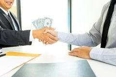 Business man give bribe to the officer stock images