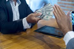 Business man give bribe to the officer but officer say no. Concept corruption Royalty Free Stock Photos