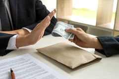 Business man give bribe to the officer but officer say no. Concept corruption stock photo