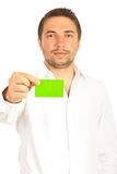 Business man give green visiting card Stock Photos