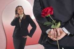 Business man gives a rose to his girlfriend. Business men gives a red rose to his girlfriend Royalty Free Stock Photo