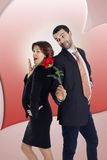 Business man gives a rose to his girlfriend. Business men gives a red rose to his girlfriend Stock Photo