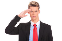 Business man gives salute Royalty Free Stock Photo