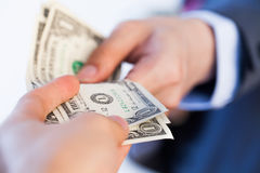 Business man giving bank notes to another person. Corruption and Royalty Free Stock Image