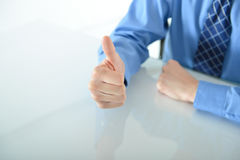 Business man giving a big thumbs up. Business or sales man giving a big thumbs up for success royalty free stock photography