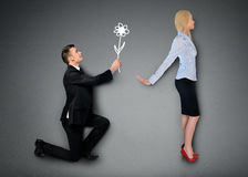 Business man giving flower Royalty Free Stock Images