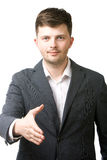 Business man giving his hand for a handshake Royalty Free Stock Photo