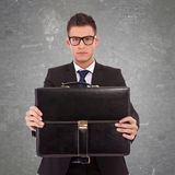 Business man giving his suitcase Royalty Free Stock Photos