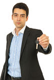 Business man giving house key Royalty Free Stock Photo